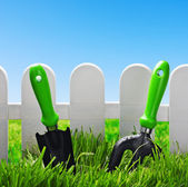 Garden tools on a green lawn — Stock Photo