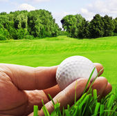 Golf ball in his hand — Stock Photo