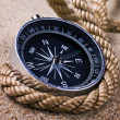 Stock Photo: Compass in the sand