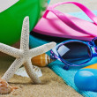 Sunblock and stuff for the beach. Focus on starfish — Stock Photo