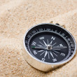 Compass on the hot sand - ストック写真