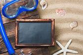 Blackboard and swim mask and snorkel — Stock Photo