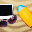 Photo frame, sunblock and sunglasses — Stock Photo