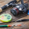Fishing tackle on a wooden table — Photo