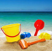 Colorful toys for childrens sandboxes against the sea — Stock Photo