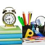 Alarm clocks and school supplies — Stock Photo #26867181