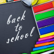 Written on the blackboard back to school — Stock Photo