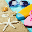 Stock Photo: Beach gear lie on sand