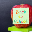Paper sticker on the apple back to school — Stock Photo