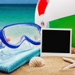 Stock Photo: Beach accessories on background of sea
