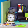 Alarm clocks and school supplies  — Stockfoto
