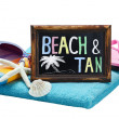 Stock Photo: Blackboard with word beach and tan
