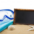 Stock Photo: Blackboard on sand and other things for beach