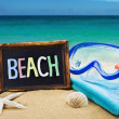 Beach accessories in the sand — Stock Photo #27212021