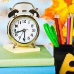 Alarm clocks and school supplies — Stock Photo #27212093
