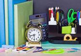 Alarm clocks and school supplies — Stock Photo