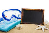 Blackboard on the sand and other things for the beach — Stock Photo