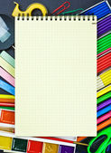 Notepad lies on the school supplies — Stock Photo