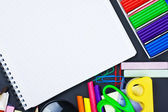 Notepad for recording and various school supplies — Stock Photo