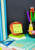 Paper sticker on the blackboard back to school — Stock Photo