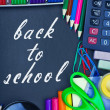 Blackboard back to school and supplies for school — Stock Photo