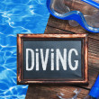 Blackboard with the words diving and swim mask — Stock Photo