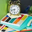 Alarm clocks and school supplies — Stock Photo