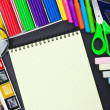 Notepad and various school supplies — Stock Photo #28472855