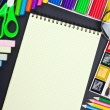 Stock Photo: Notepad and various school supplies