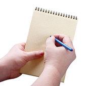Ruce s perem na papír — Stock fotografie