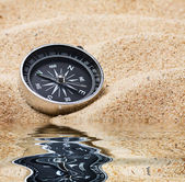Compass in the sand — Stock Photo