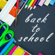 Written on the blackboard back to school and supplies — Stock Photo