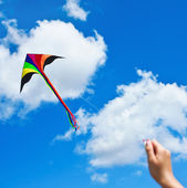 Kite flying in a beautiful sky clouds — Stock Photo