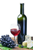 Glass of red wine and grape isolated — Stock Photo