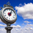 Old retro street clock on a sky  — Stock Photo