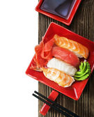Japanese seafood sushi and chopsticks — Stock Photo