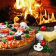 Pizza with mushrooms and cheese served on wooden table — Stock Photo