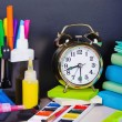 Stock Photo: Alarm clocks and school supplies