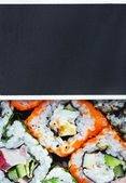 Japanese rolls and blackboard for text — Stock Photo