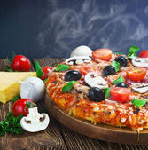 Italian pizza with mushrooms and cheese served — Stock Photo