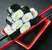 Pyramid of rolls on sticks for sushi. Focus on the top roll — Stock Photo