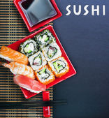 Rolls and sushi and chopstick — Stock Photo