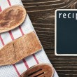 Kitchen utensils and a blackboard to write a recipe — 图库照片