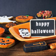 Halloween cookies and holiday greetings — Stock Photo