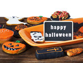 Halloween cookies and black label and holiday greetings — Stock Photo