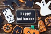 Handmade cookies for Halloween and the black plate for greetings — Stock Photo