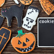 Halloween cookies on a wooden background — Stock Photo