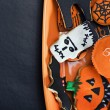 Stock Photo: Halloween cookies on plate orange