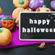 Candy for Halloween and blackboard — Stock Photo