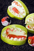 Jaw with teeth of apples and nuts for Halloween — Stock Photo